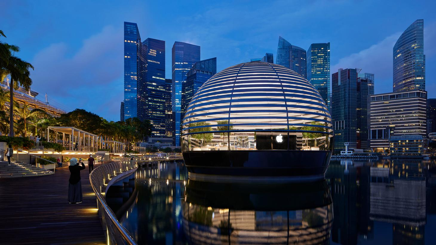 A moody exterior view of Apple Marina Bay Sands at night time