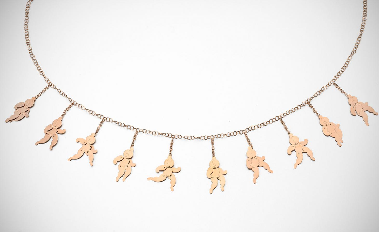 Necklace of small women dancing