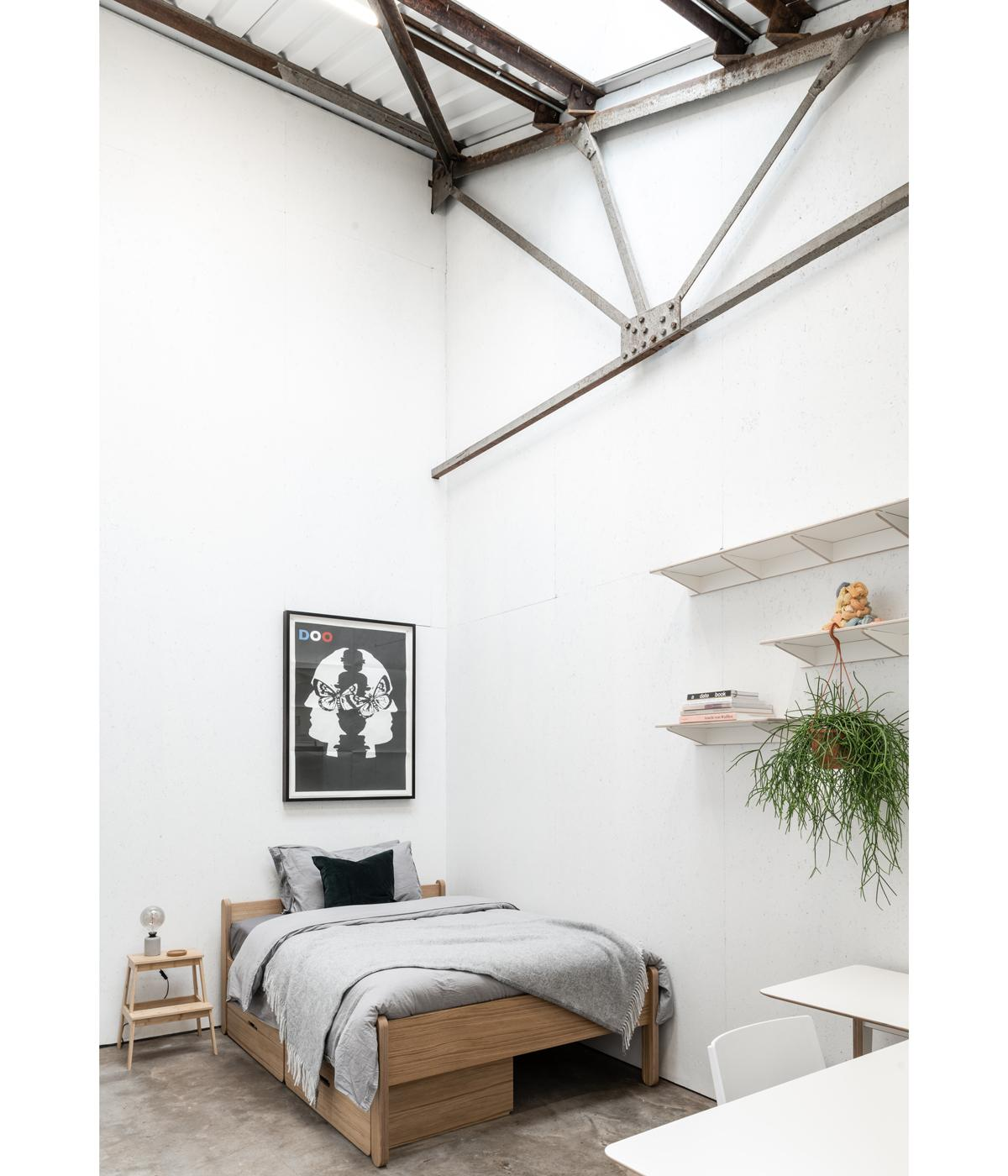 bed in a white room