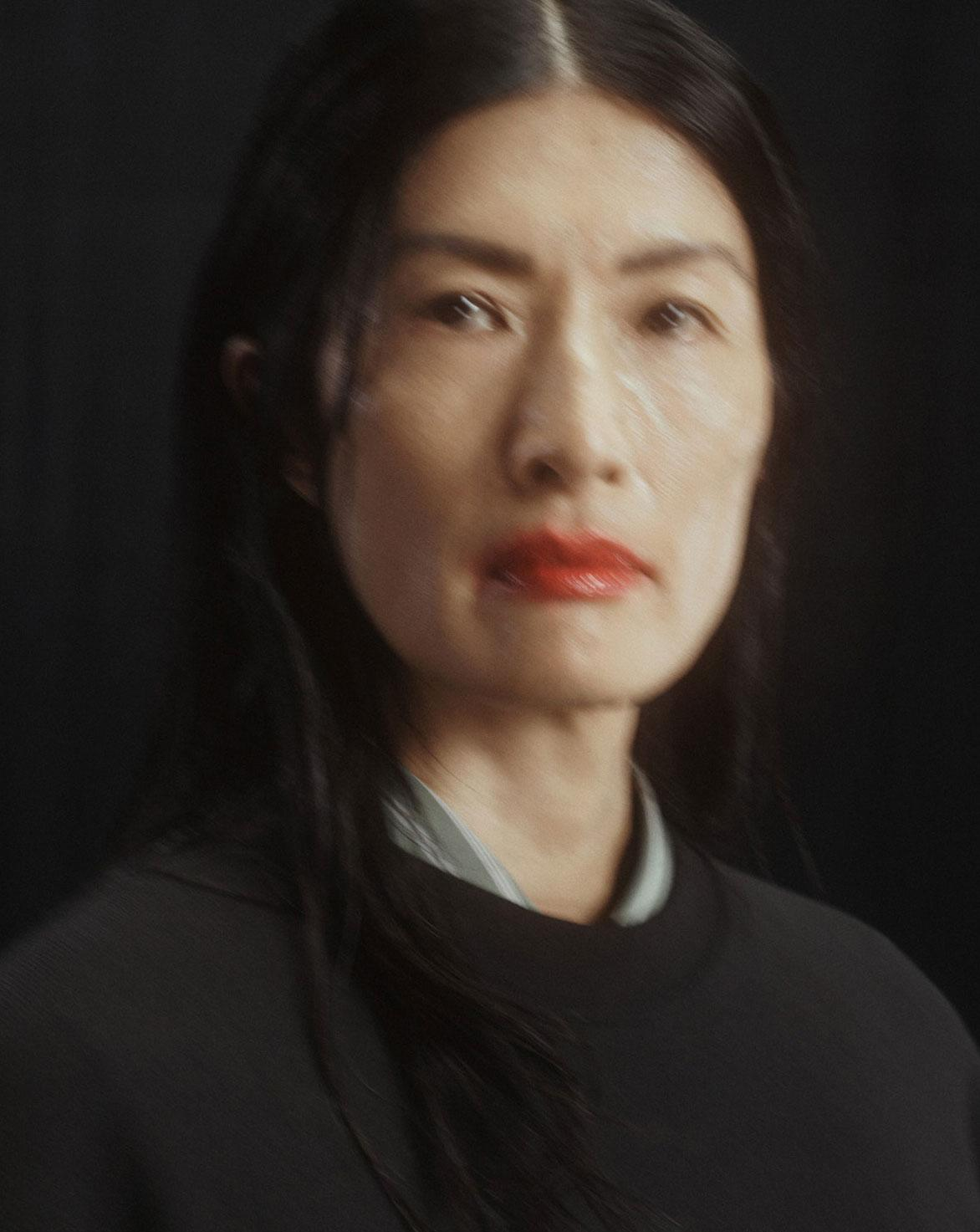 Dries Van Noten A/W 2021 beauty model with smudged glossy red lipstick and slicked back hair