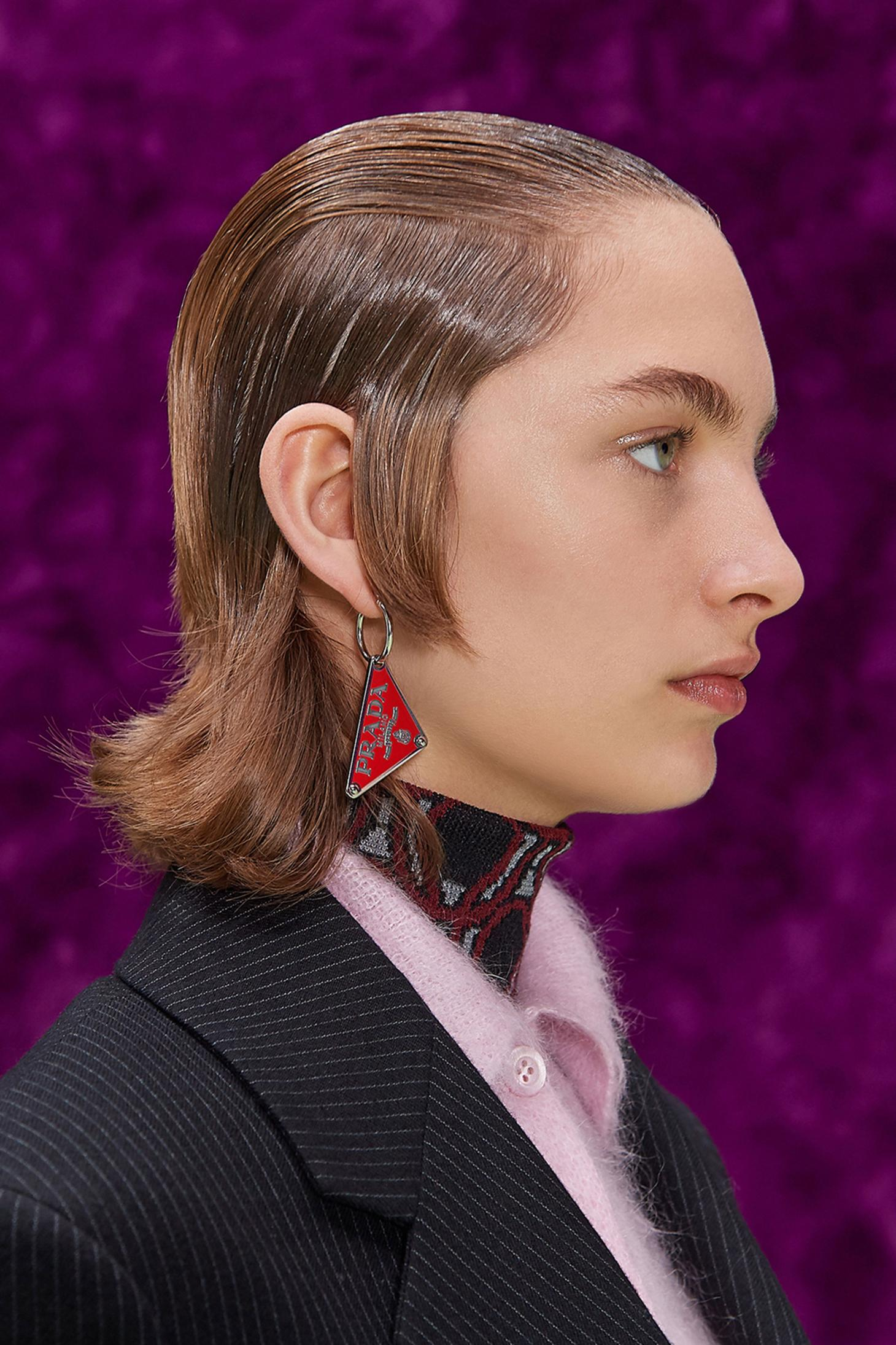 Prada A/W 2021 model wit slicked back hair by Guido Palou and Pat McGrath makeup