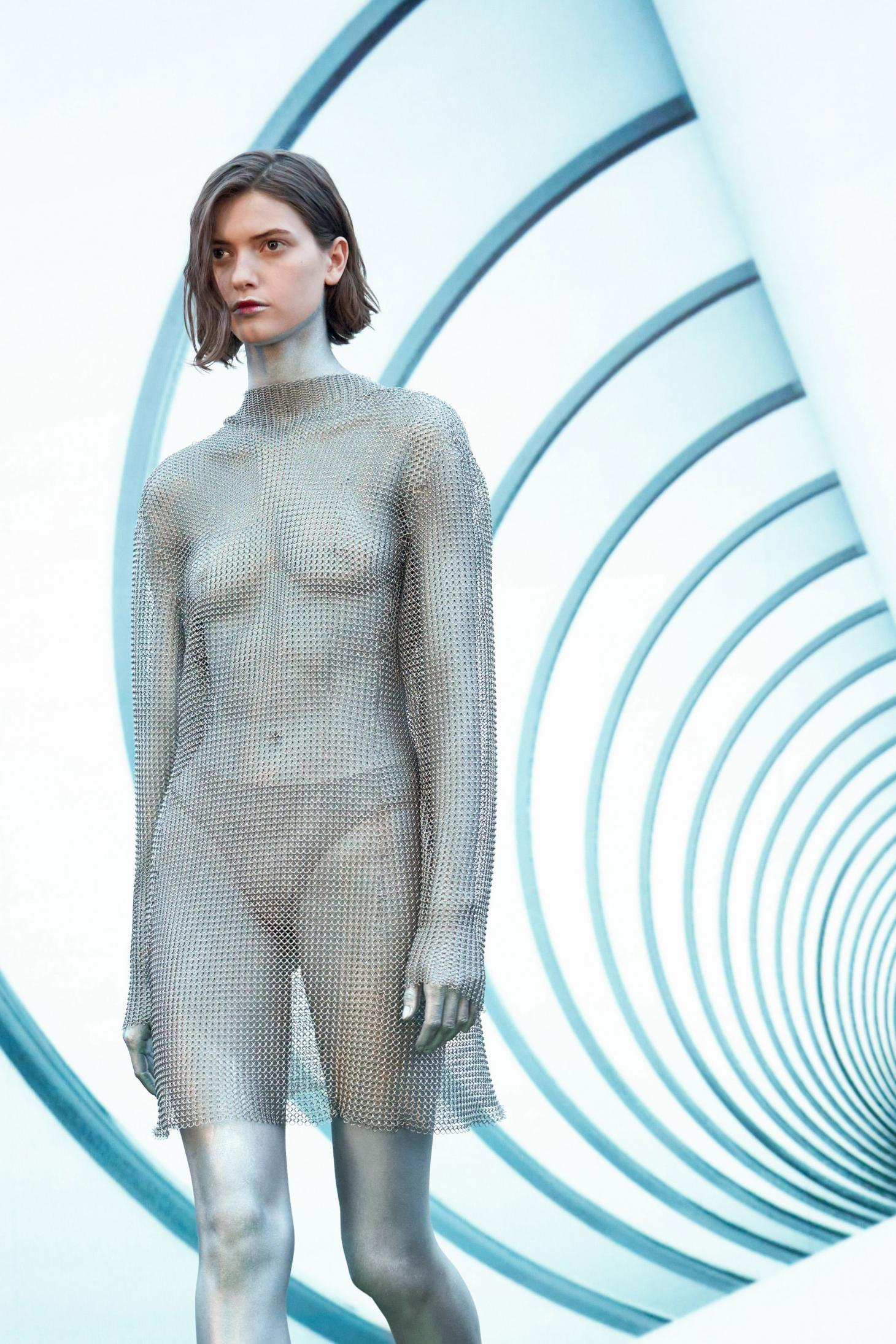 Salvatore Ferragamo beauty A/W 2021 with woman in silver body paint and silver chain mail