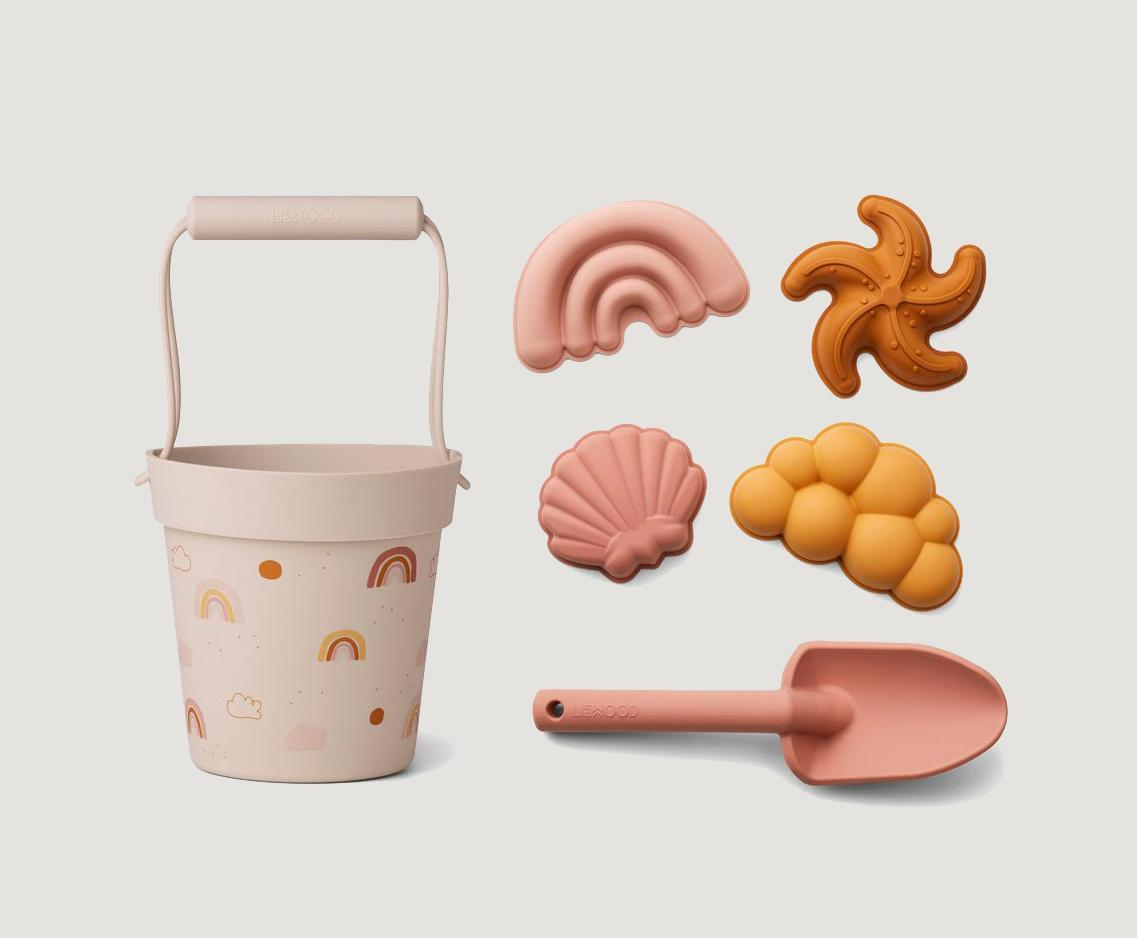 Liewood silicone beach toy set four sand moulds, a sand bucket, and a small shovel