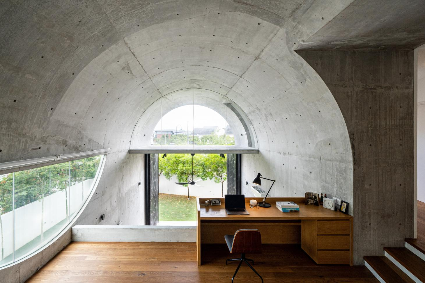 study under the concrete barrel vaulted roof at Bewboc house in Malaysia