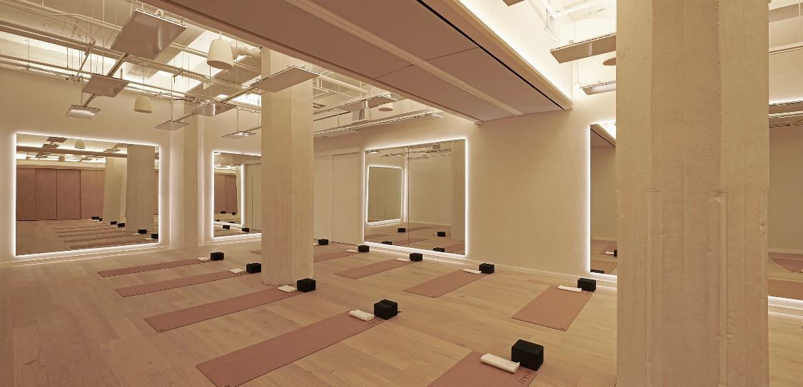 Workout room at Bian spa in Chicago with beige wall and pink workout mats