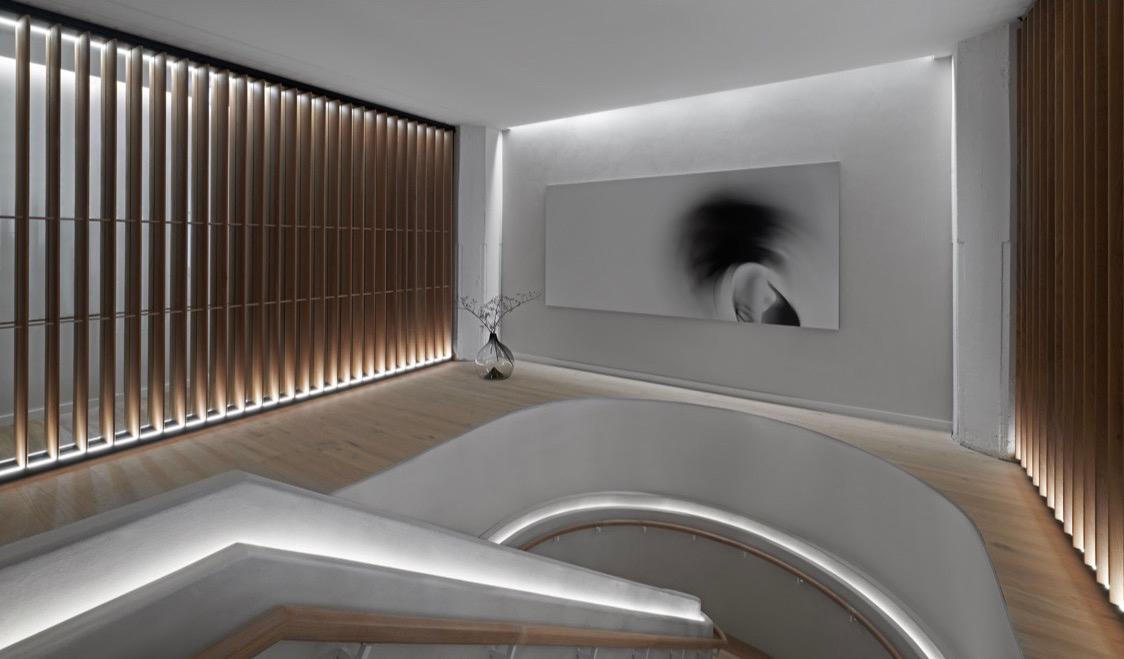 Stairs at Bian spa in Chicago with white walls and black and white picture