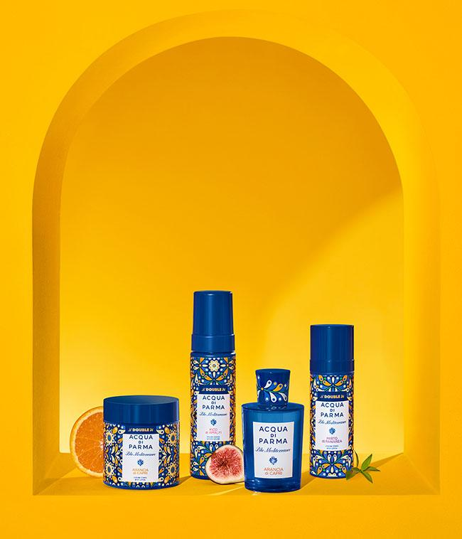 acqua di parma and la double j products against a yellow background