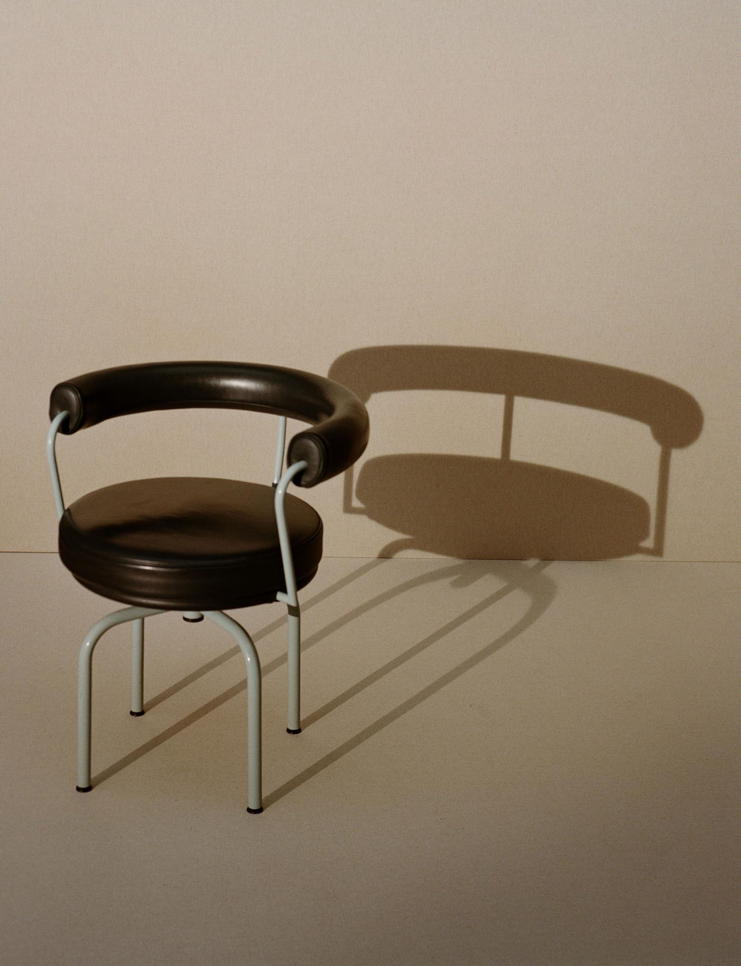 Julien T Hamon photograph of black LC7 Armchair designed by Charlotte Perriand