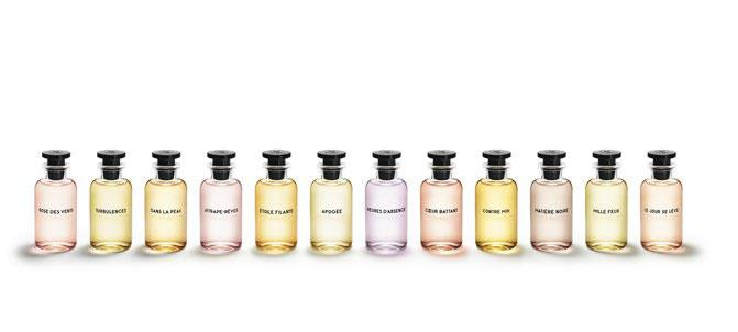 collection of pastel coloured Louis Vuitton fragrance bottles against white background