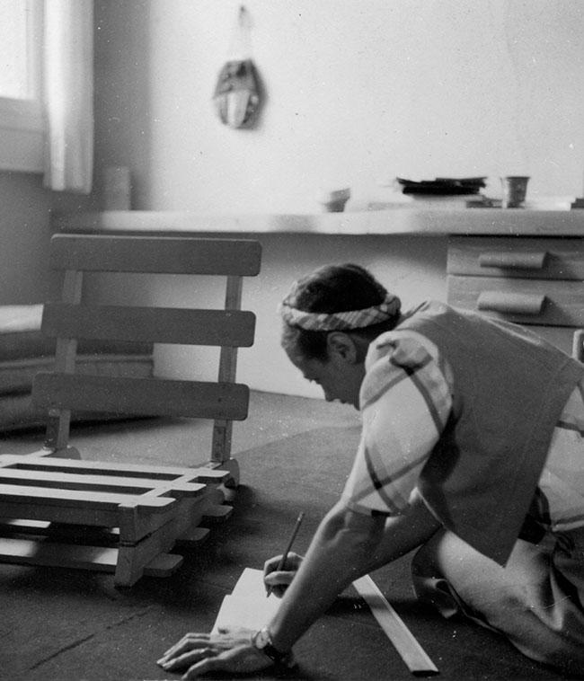 black and white image of Charlotte Perriand working in Japan