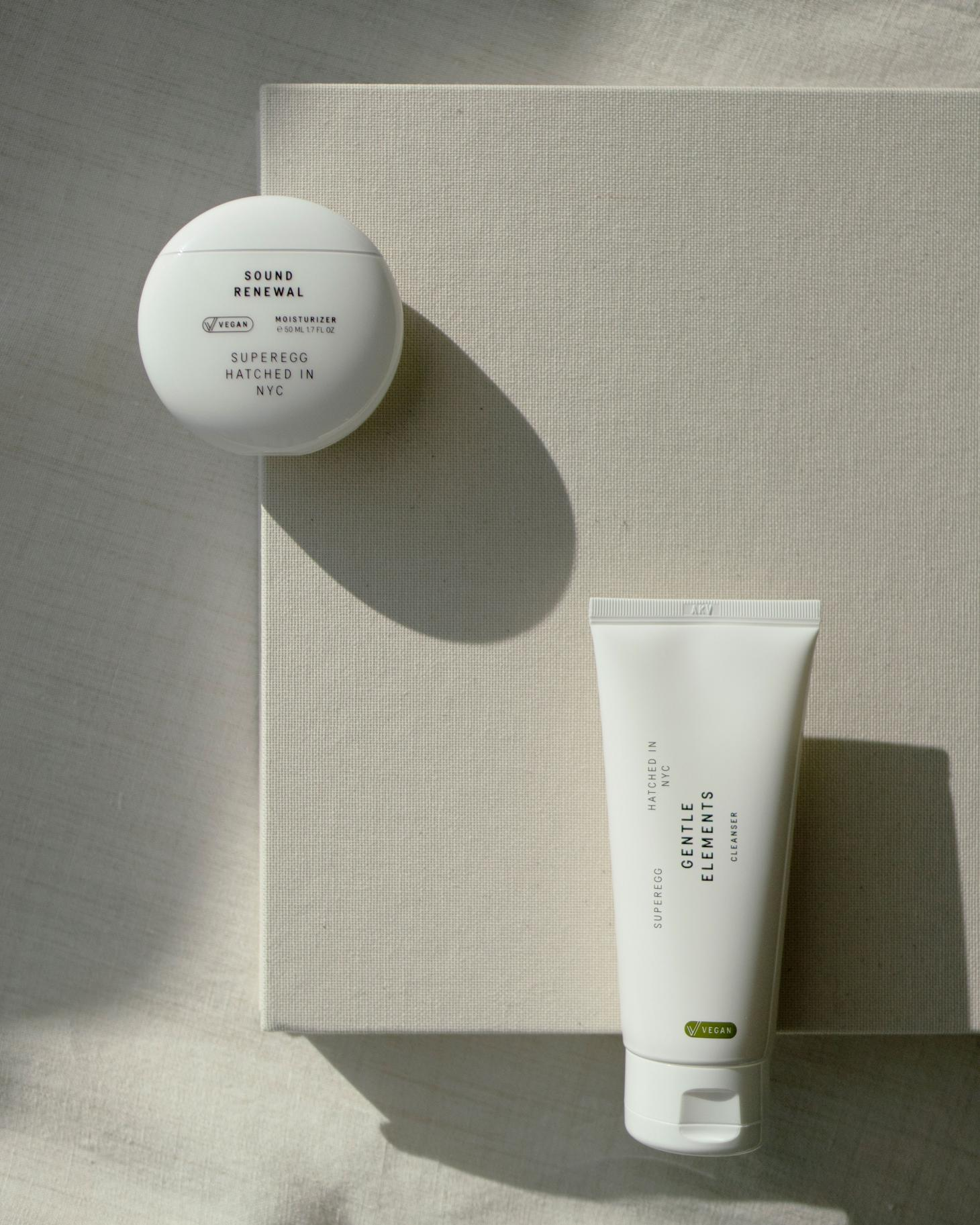 superegg vegan skincare moisturiser and cleanser in white bottles against white background