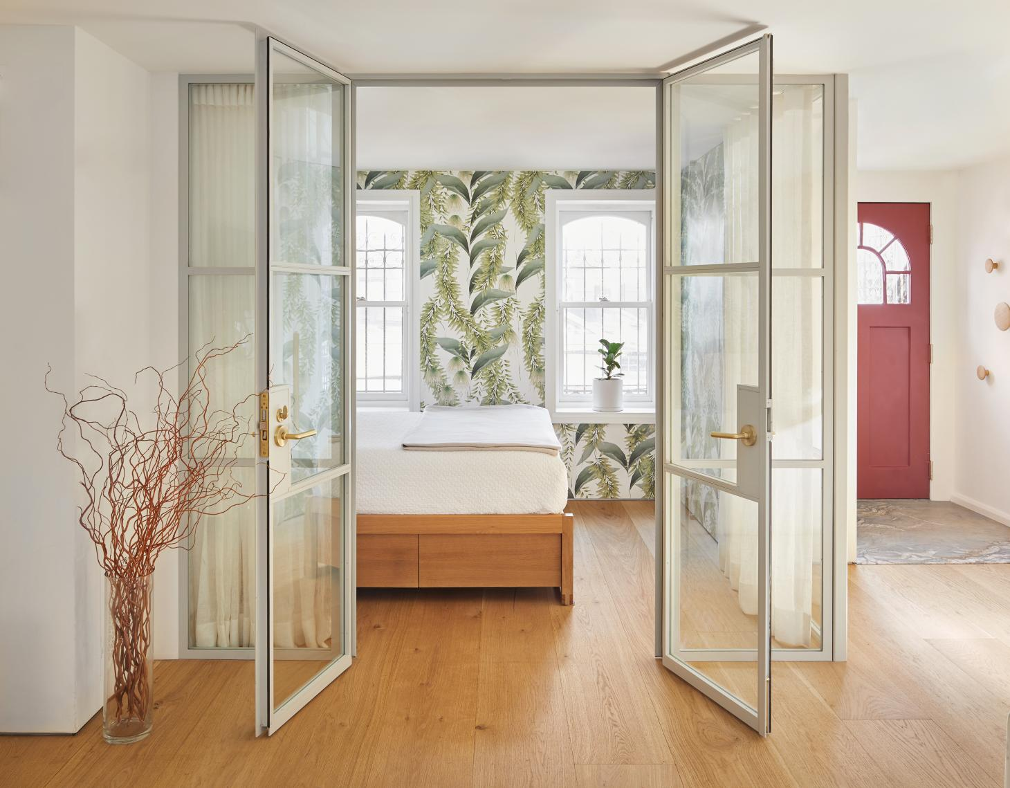 guest room with nature inspired wallpaper at Boerum Hill townhouse
