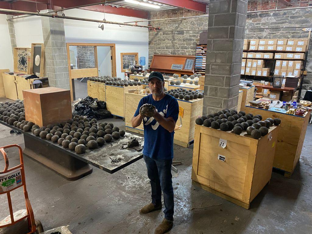Artist Bosco Sodi in his Red Hook studio with the clay spheres that will be used in his Tabula Rasa public art installation