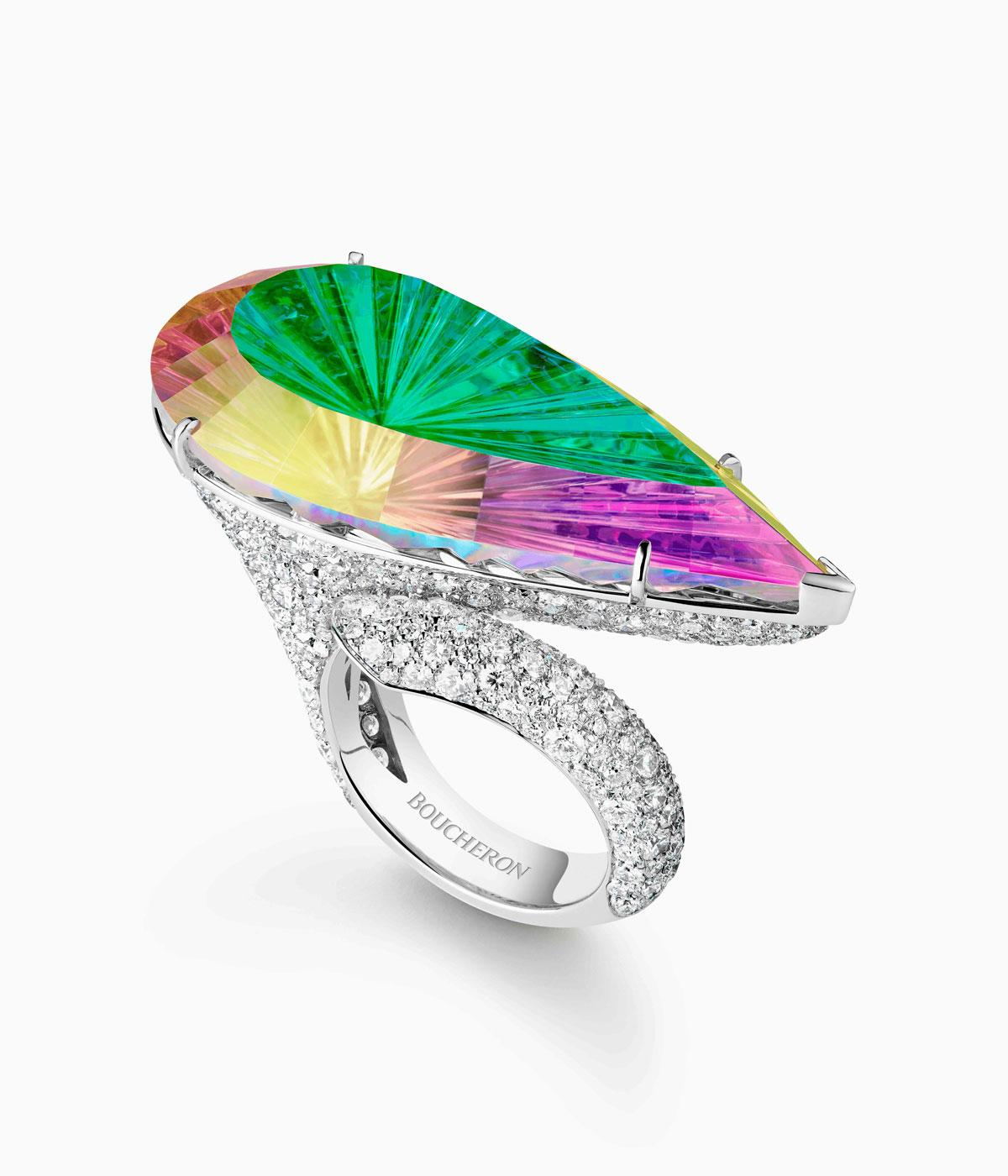 Ring in rainbow precious stones on a daimond mount
