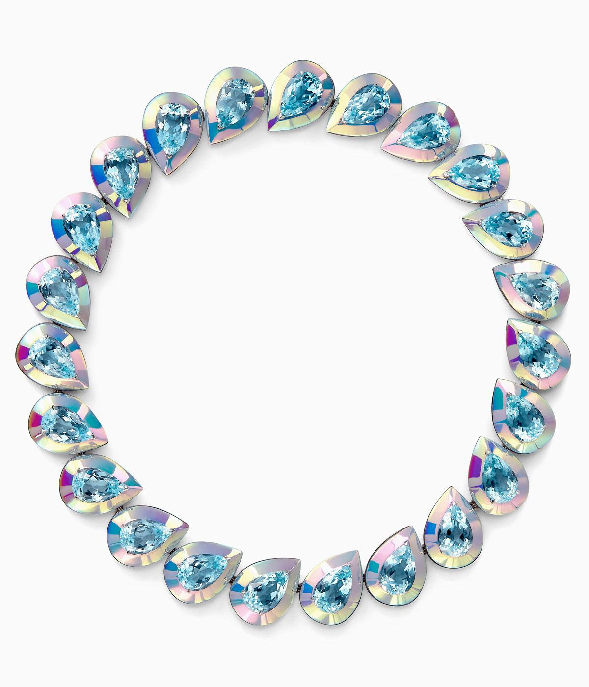 Necklace of sapphires edged in holographic material