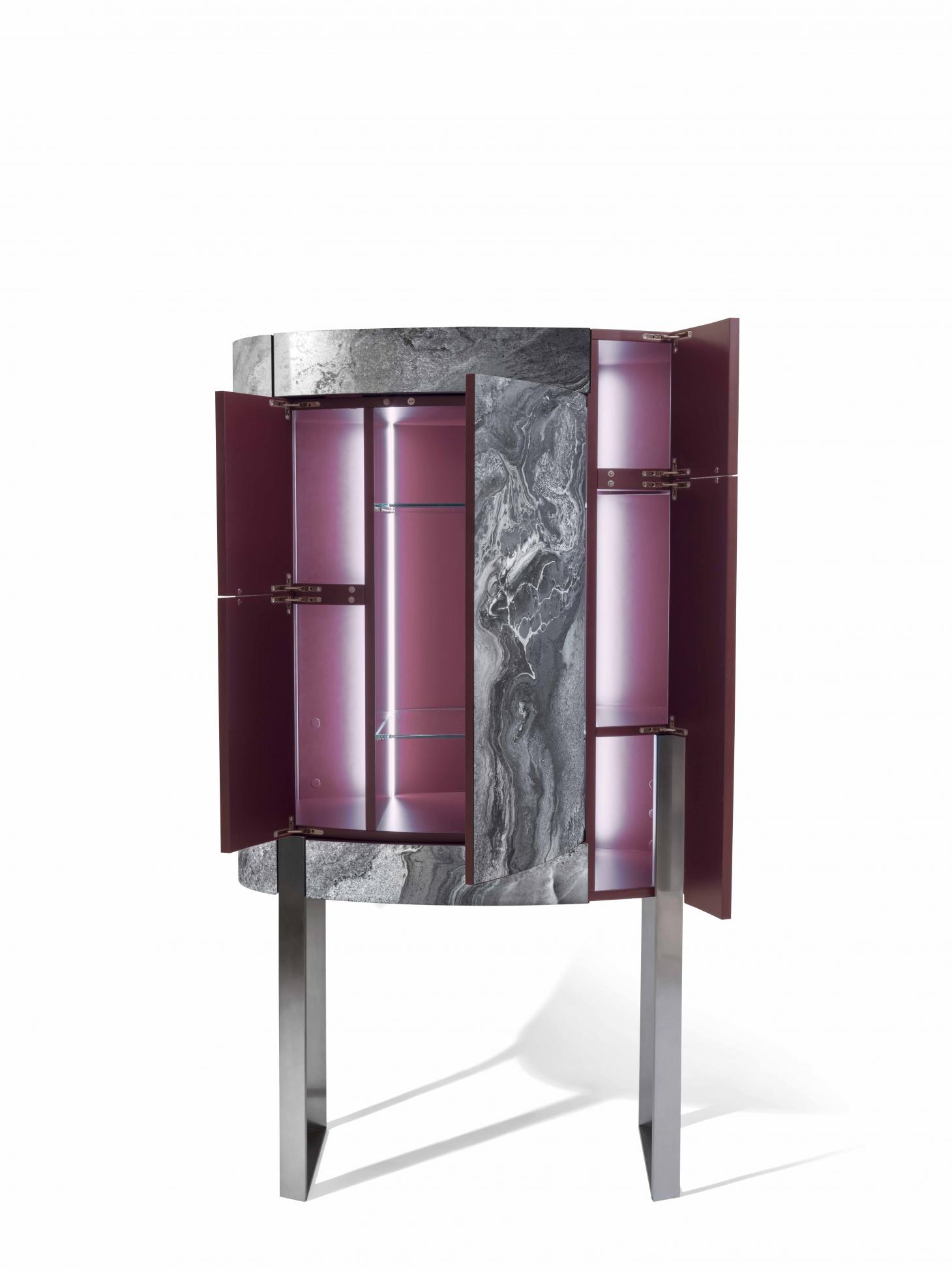 A tall drinks cabinet with open doors. The outside is clad in metal sheet with marbled effect, while the inside is made of wood painted burgundy colour