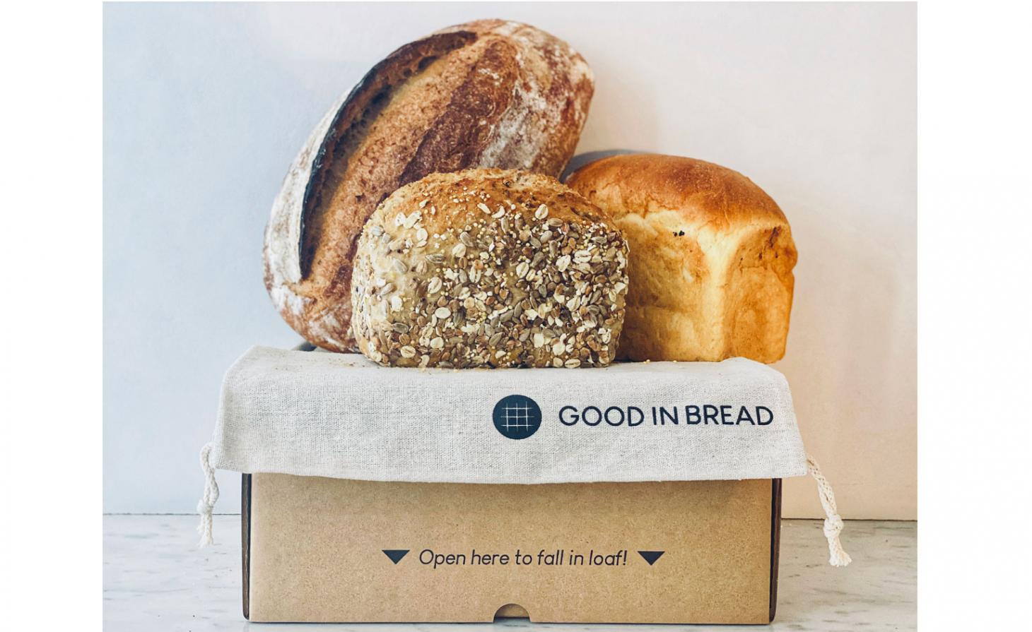 box with three loaves of bread in it