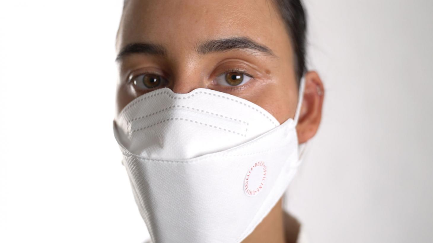 woman wearing a surgical mask with one of Buly 1803's perfumed mask stickers