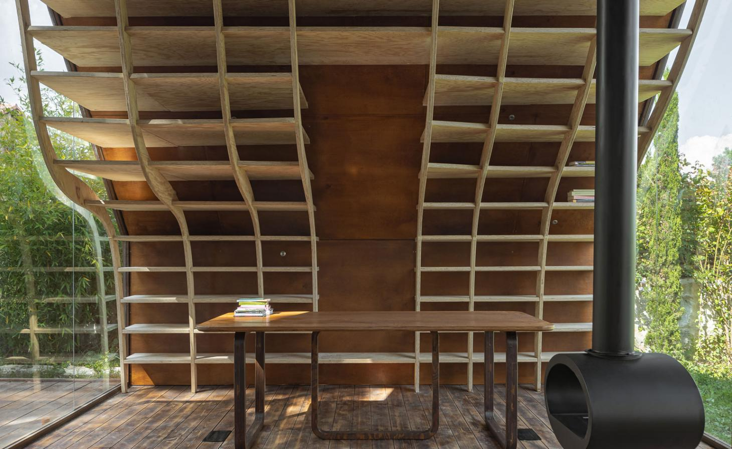 Cabin with curving wooden bookshelves