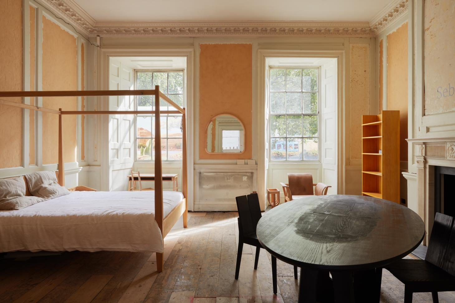 Domestic setting with bed and table by Sebastian Cox
