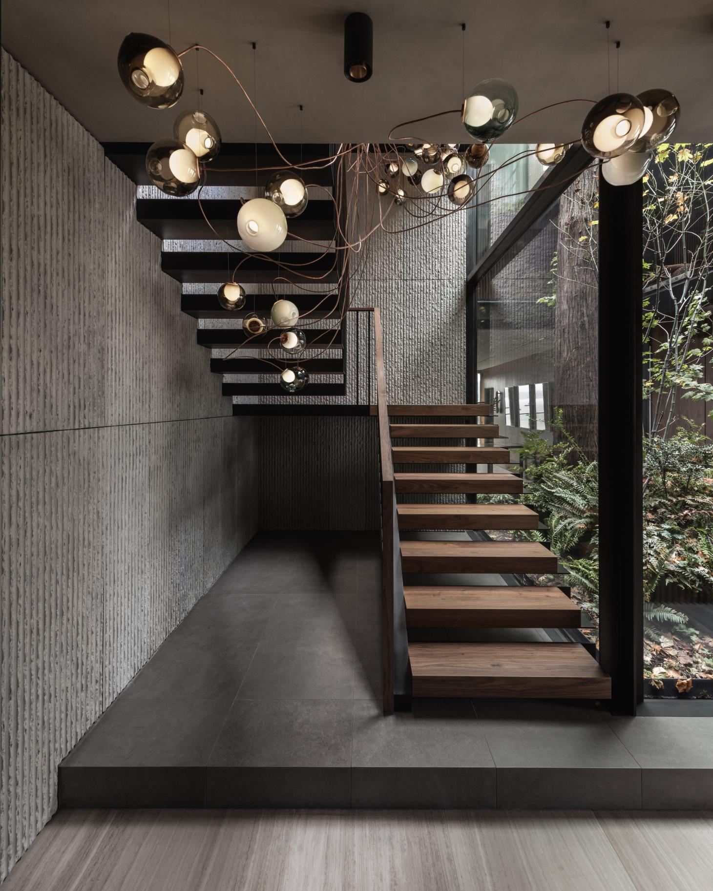 striking staircase with sculpture lighting at the Vancouver House Penthouse