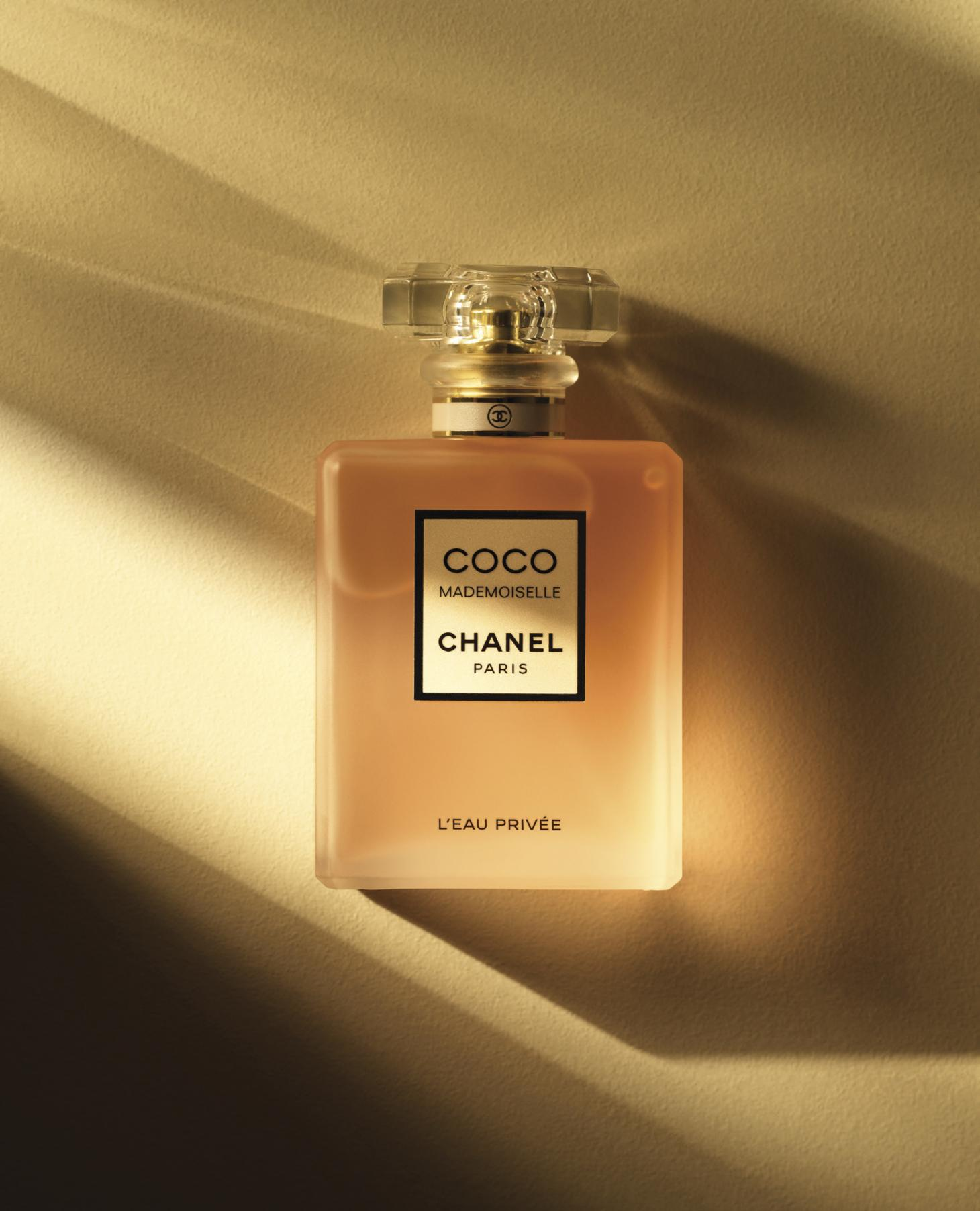 Fragrance bottle from Coco Chanel Madmoiselle beautifully presented on a cream backdrop