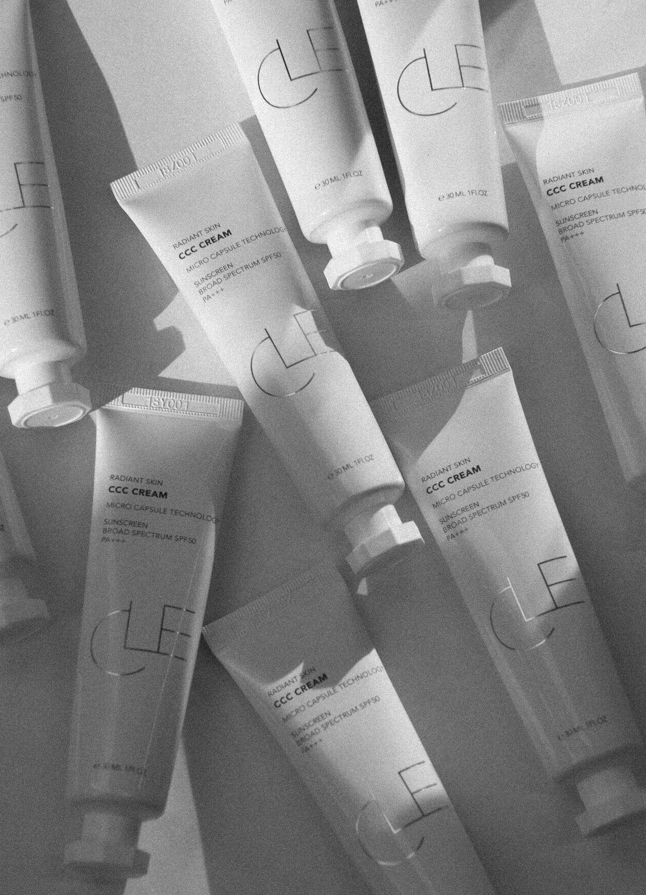 White bottles of Cle's CCC cream Korean sunscreen and skincare