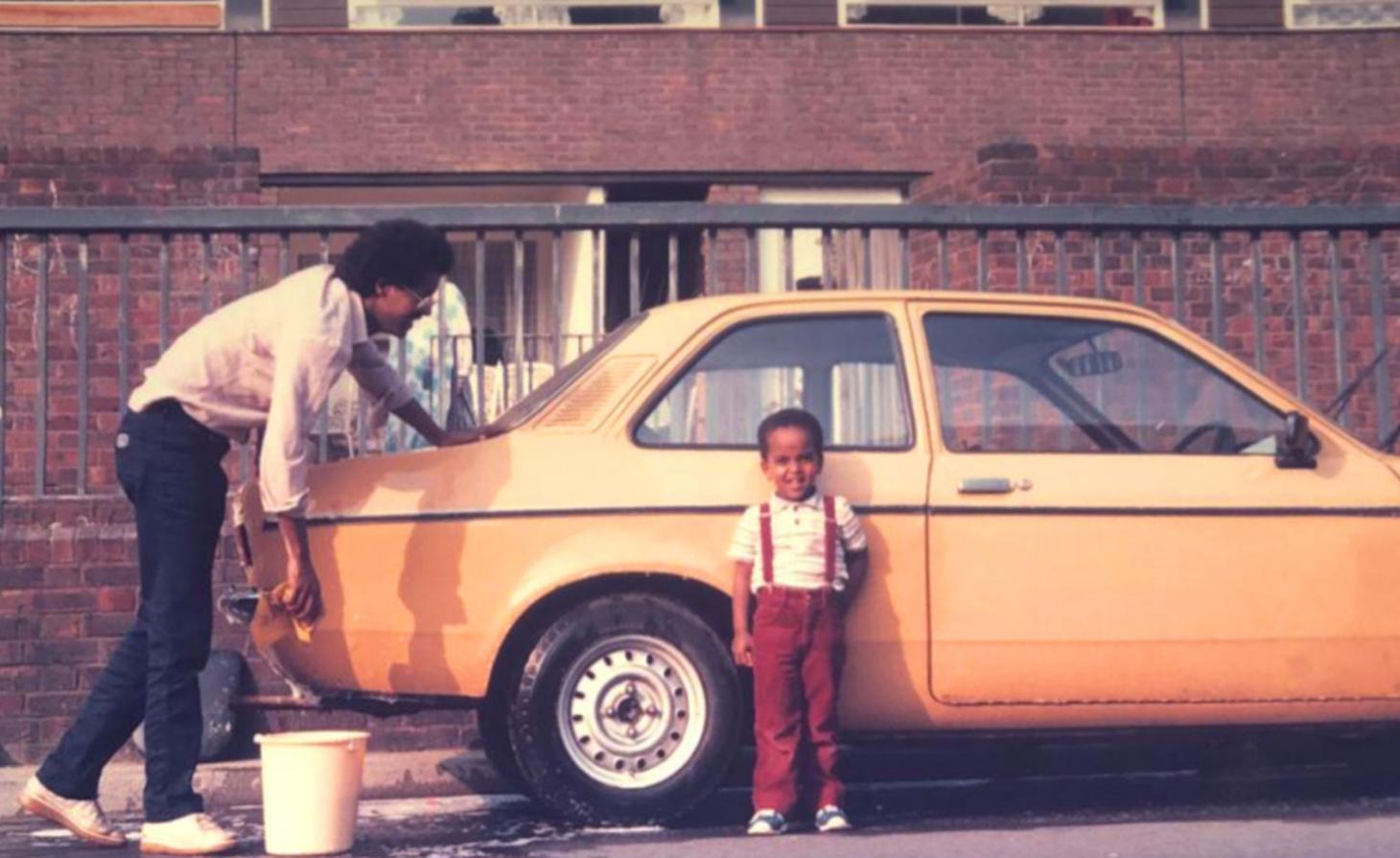 Jonathan Hagos as a child in front of his parents pink car