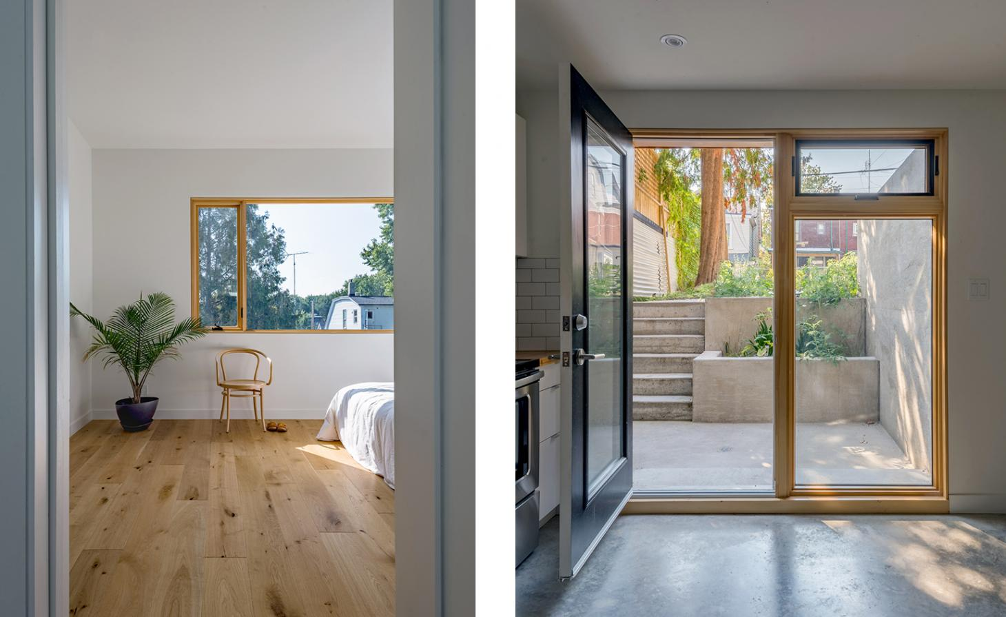 minimalist bedroom and view out to the garden in Toronto townhouse with bright yellow front porch