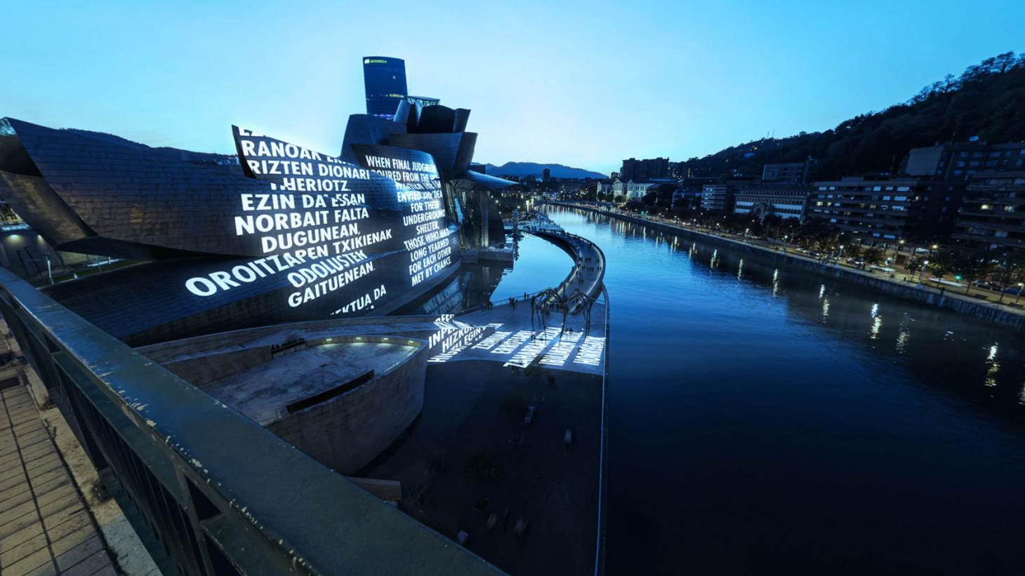 LIKE BEAUTY IN FLAMES, 2021 by Jenny Holzer, an AR text installation at the Guggenheim Bilbao in Spain