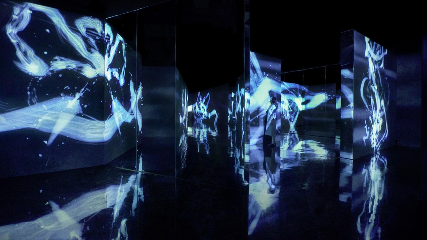 A room with blue streaks of light projected onto wall dividers
