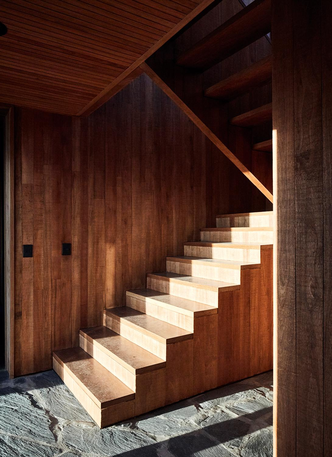 Internal wood stairs with stone flooring