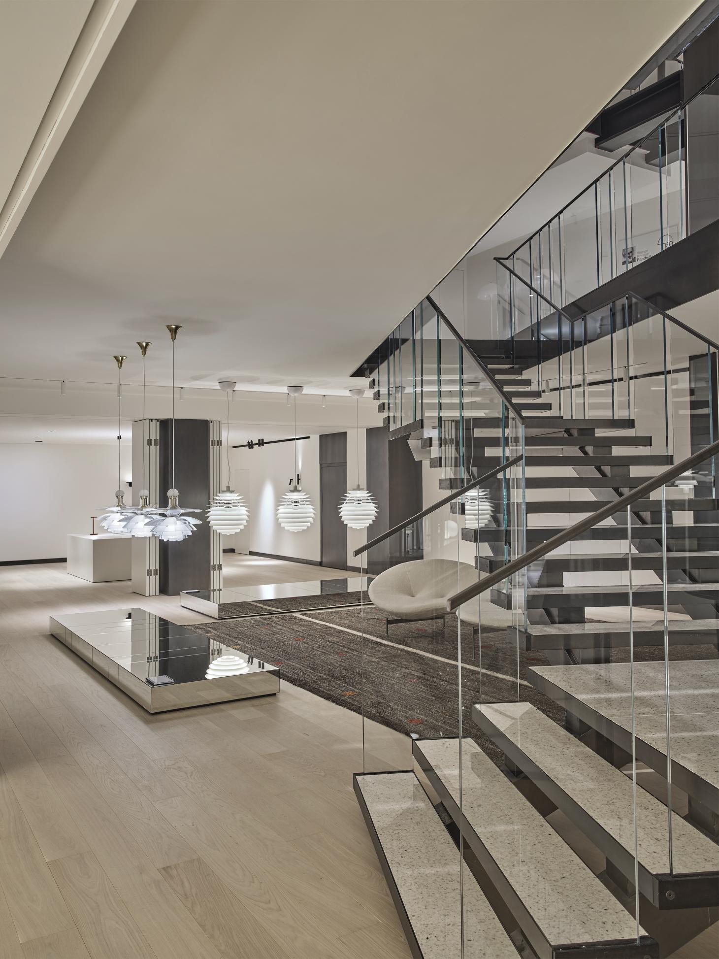 Lighting displays by Louis Poulsen next to a staircase