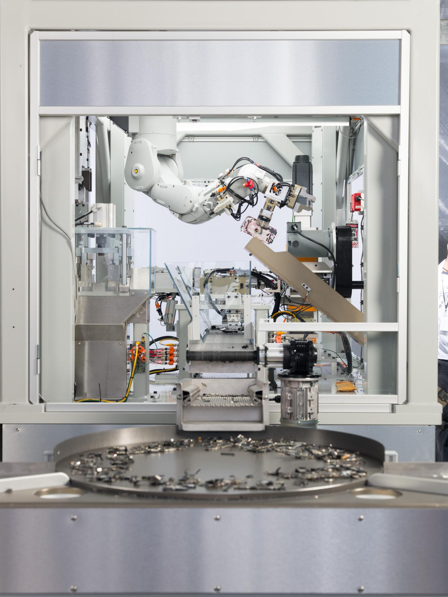Apple's robot Daisy retrieves end of life consumer materials for recycling