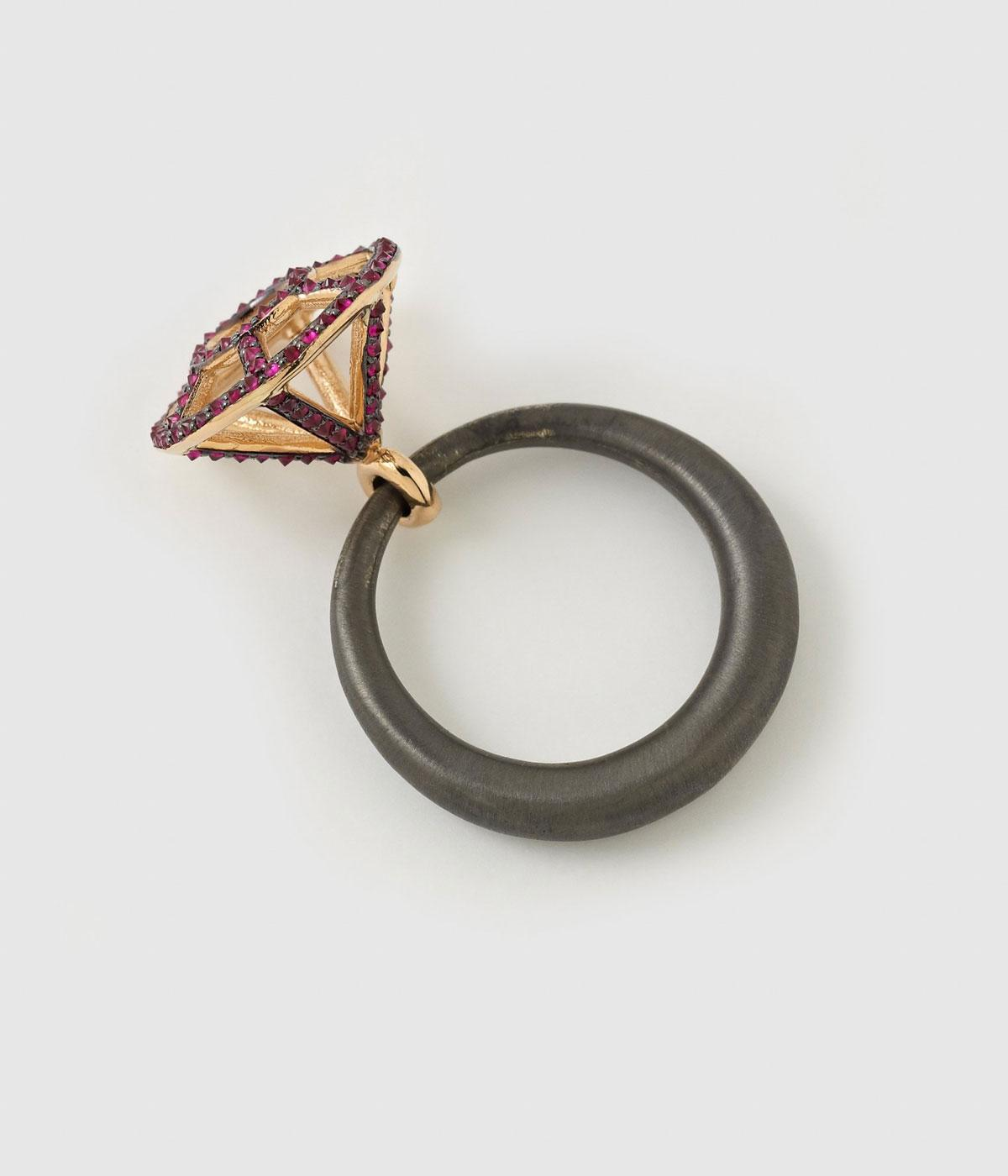 A cage of rubies on a black ring