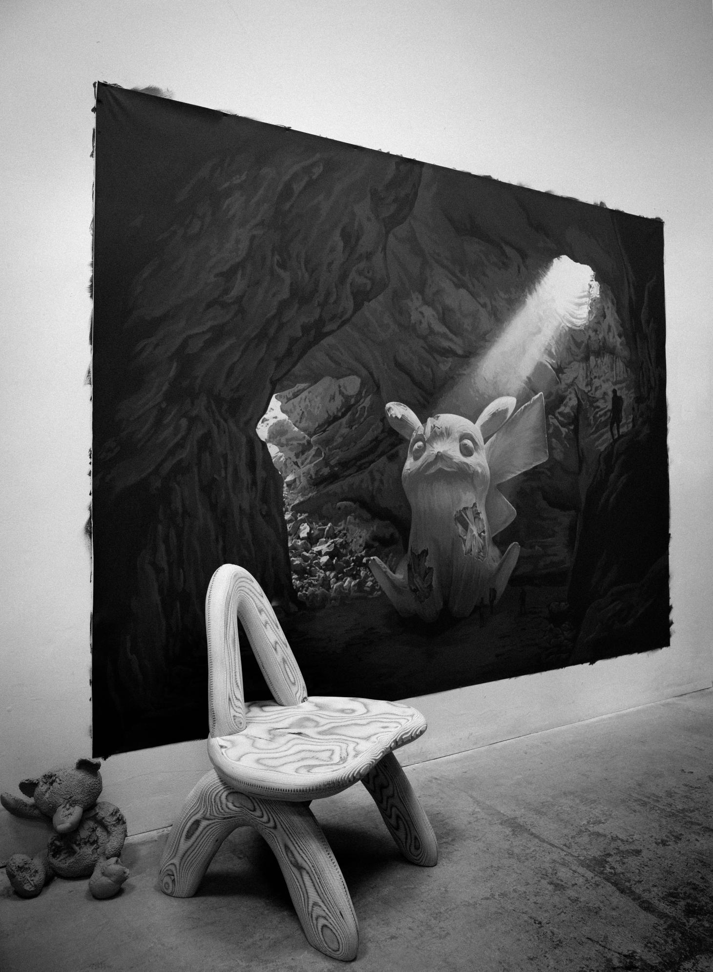 Black and white photograph of Daniel Arsham furniture and artwork, including a stone chair from Objects for Living II