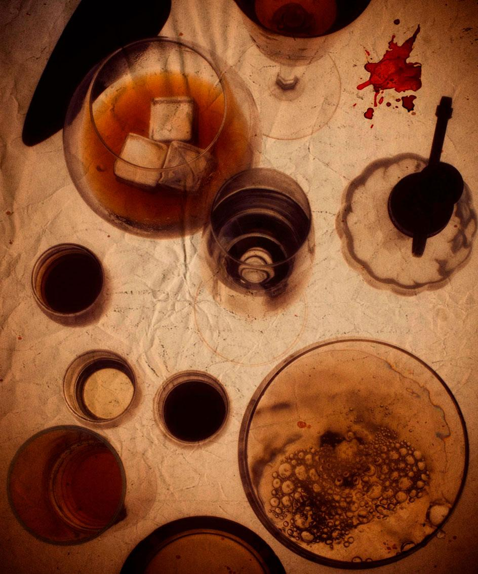 Photograph of multiple drink glasses on crumbled while tablecloth by Deadhungry at Selfridges Cinema