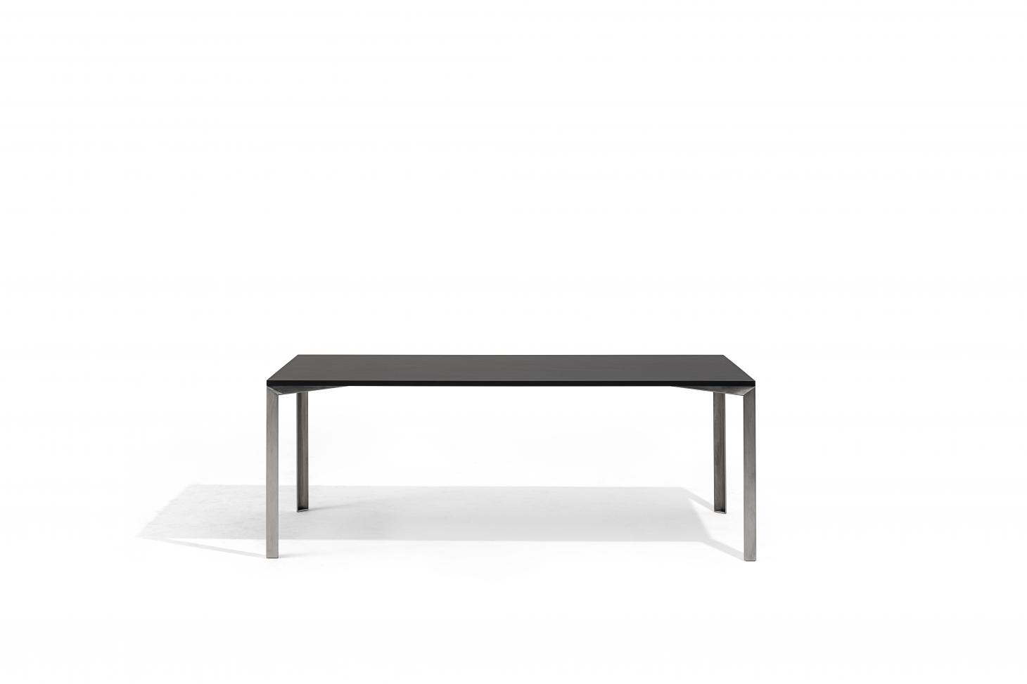 Long rectangular dining table with metal legs and slim black table top