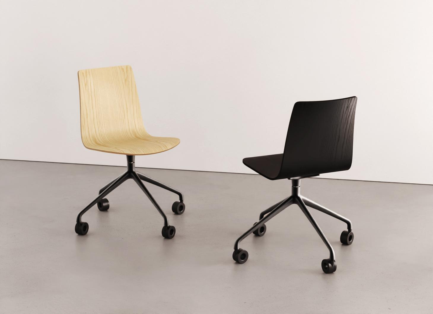 Two office chairs, in natural wood and black stained wood, with wheels, by Dims