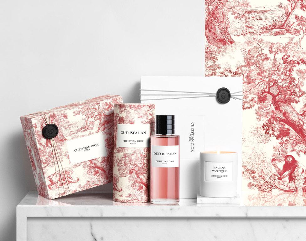 Dior pink Oud Ispahan fragrance on marble tabletop with the limited edition red Toile de Jouy packaging