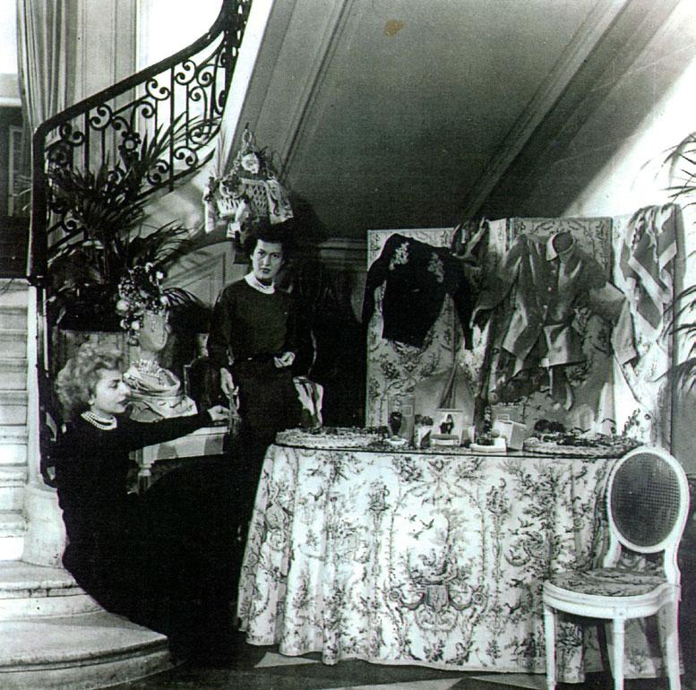 Two women at the perfume table in Dior's original Parisian boutique
