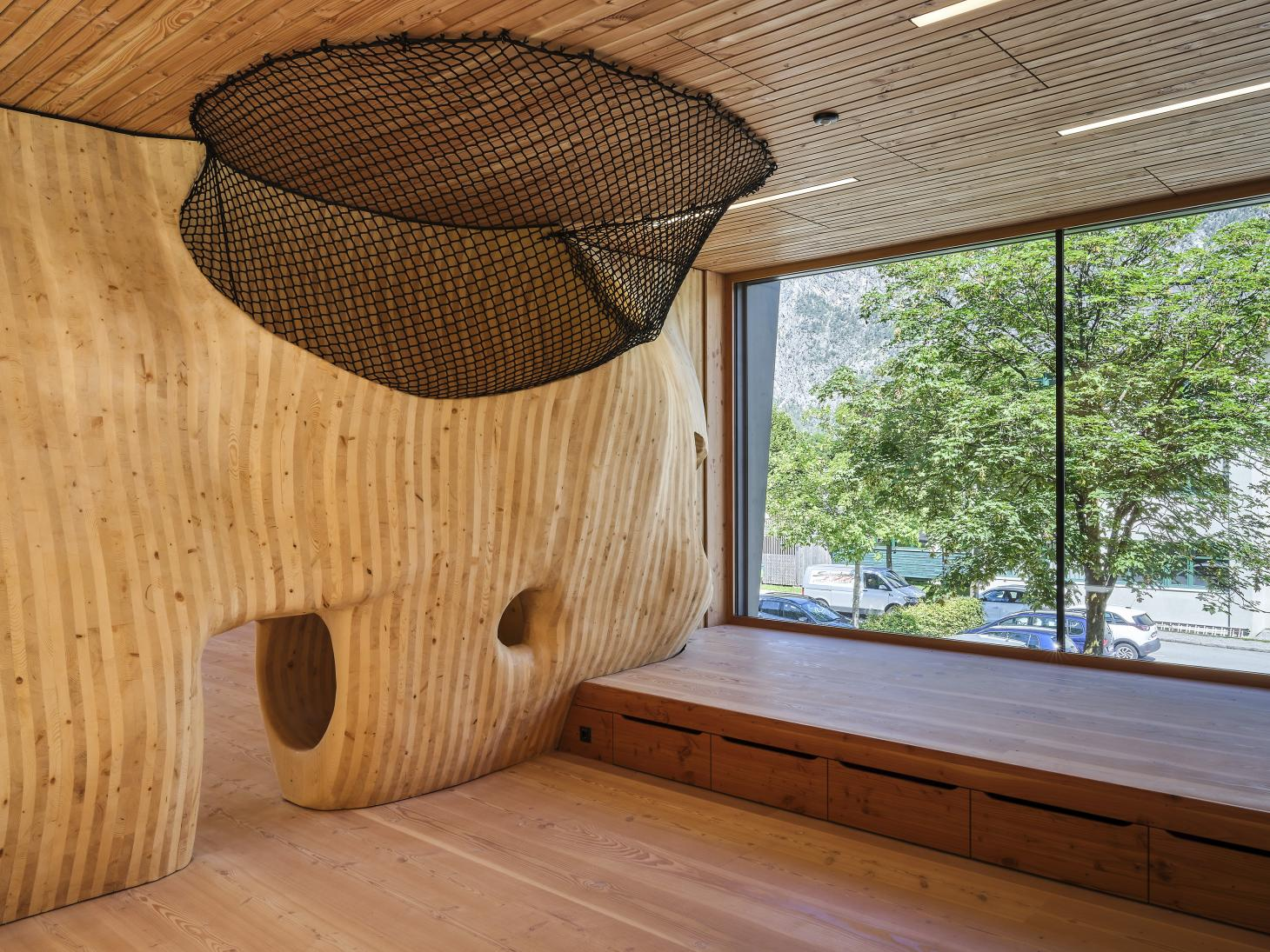 organic structures and large openings at Austrian Kindergarten