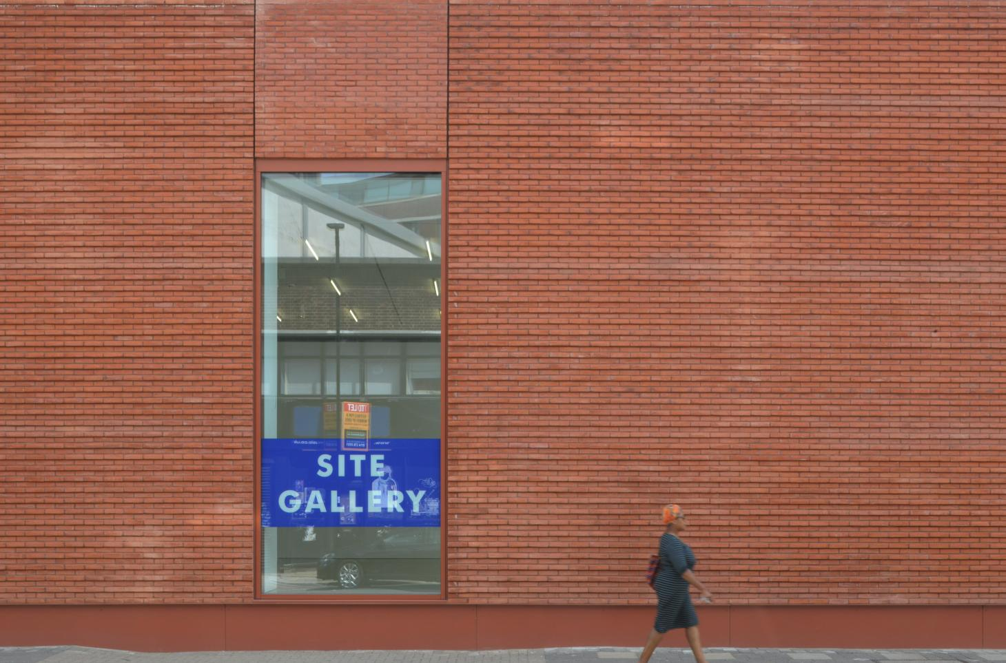 Red brick facade at Site Gallery