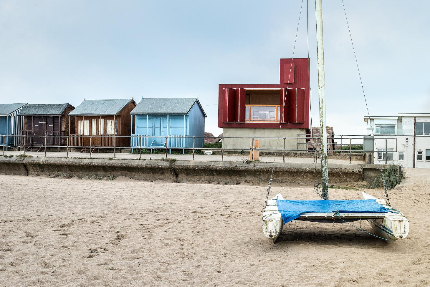 Colourful seaside cabins designed by architects on a beach
