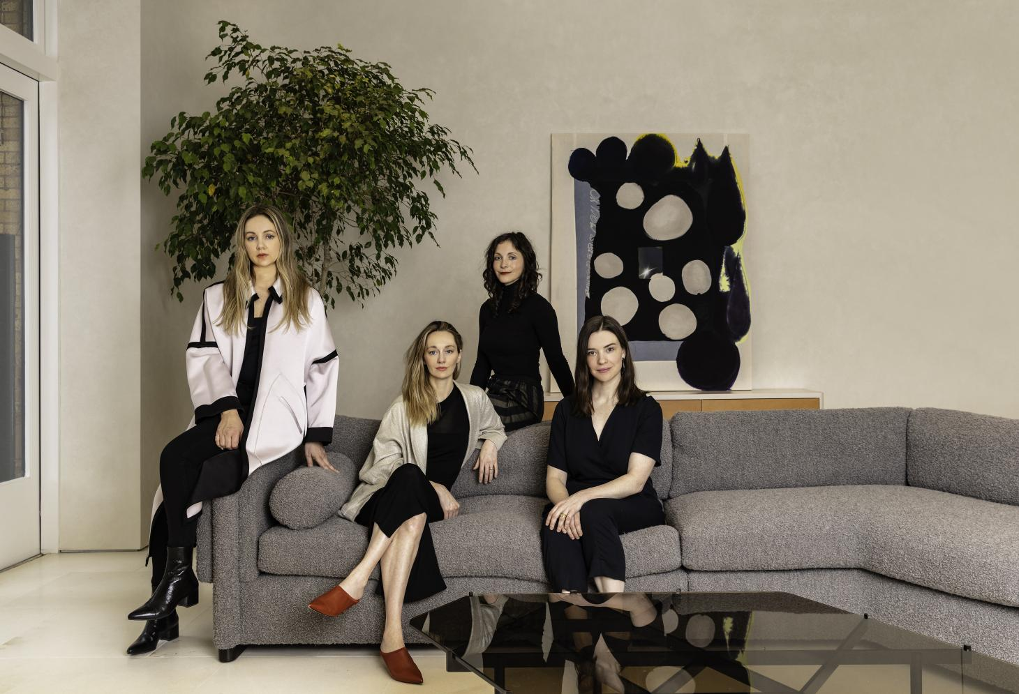 Female designers and curators Crystal Ellis, Hillary Petrie, Stephanie Beamer and Tealia Ellis Ritter on grey couch