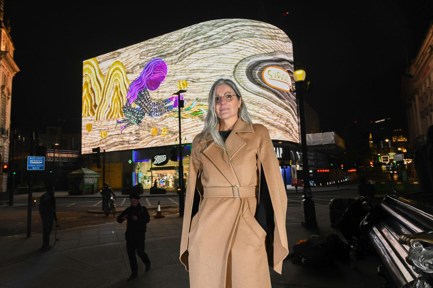 Artist Emma Talbot (wearing Max Mara) at the firstscreening for her CIRCA commission in Piccadilly Circus