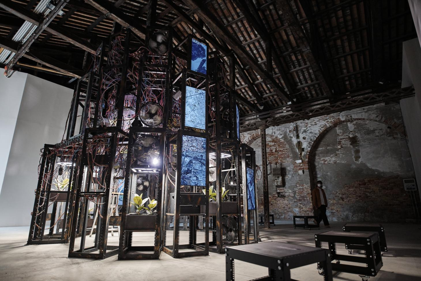 The Irish Pavilion's installation at the 2021 Venice architecture biennale is made of a massive wooden structure crammed with video screens
