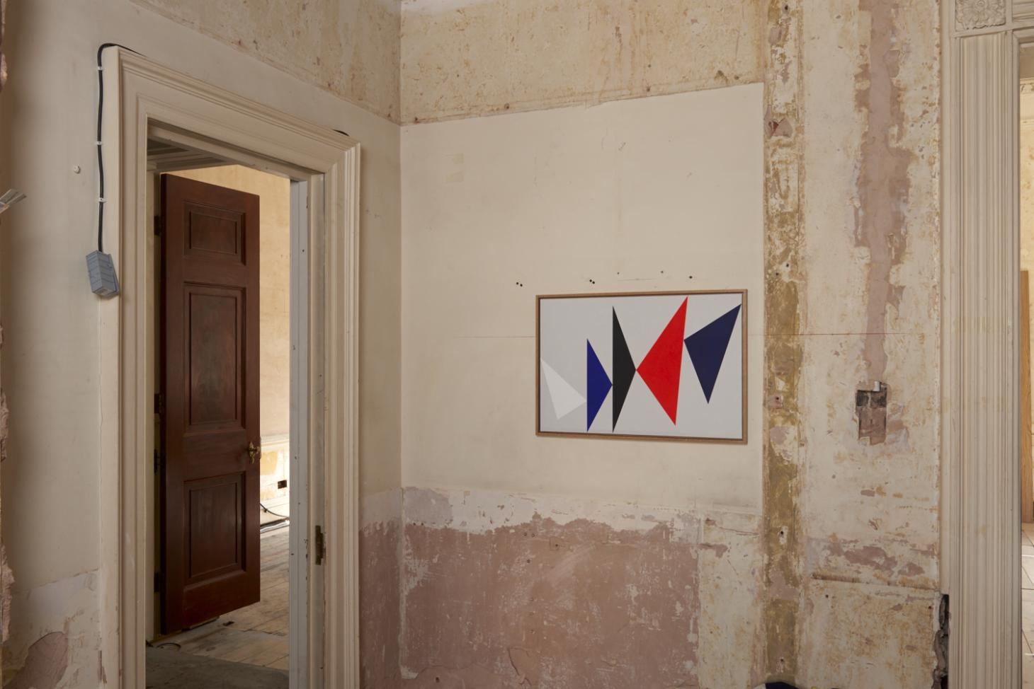Painting featuring triangles in red and blue