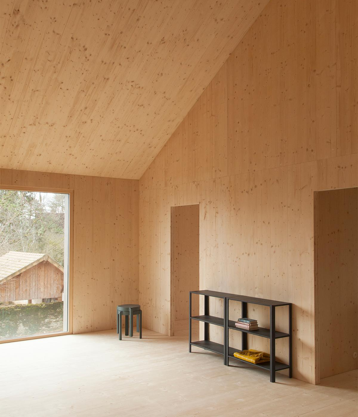 Minimalist furniture by Stattmann Neue Moebel inside Atelier ordinare's wood house prefab