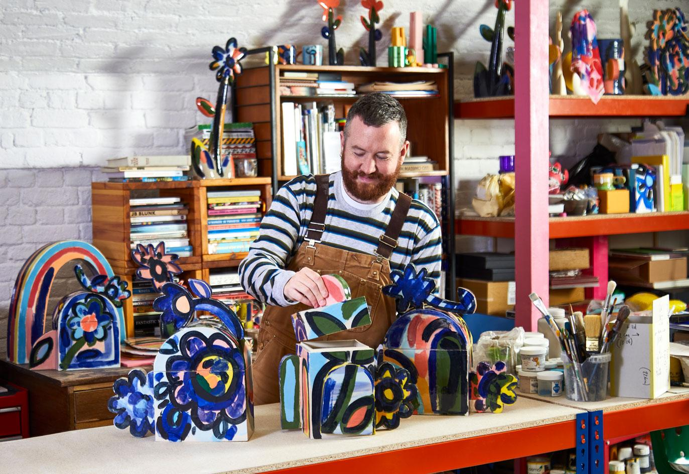 John Booth with ceramic funeral urns 'A Colourful Life' created with UK death specialists Farewill